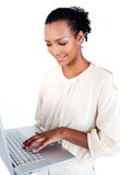 Attractive businesswoman using a laptop Stock Photo