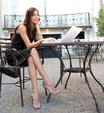 Businesswoman with laptop in cafe. Royalty Free Stock Photos