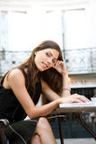 Businesswoman with laptop in cafe. Attractive businesswoman using a laptop computer while sitting in a coffee shop, outdoors Royalty Free Stock Photography