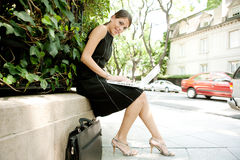 Business woman with laptop in street. Royalty Free Stock Photo