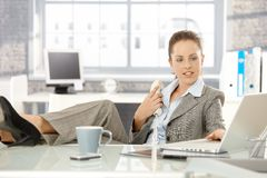 Attractive businesswoman using laptop in office Royalty Free Stock Photography