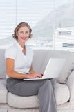 Attractive businesswoman using laptop Royalty Free Stock Photos