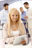 Attractive businesswoman using tablet Stock Photos