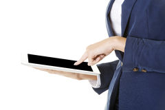 Attractive businesswoman using tablet computer Stock Images