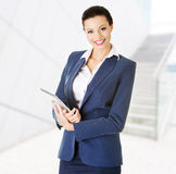 Attractive businesswoman using tablet computer Royalty Free Stock Photo