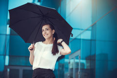 Attractive Businesswoman is walking in city Stock Images