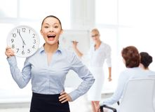 Attractive businesswoman with wall clock Royalty Free Stock Images