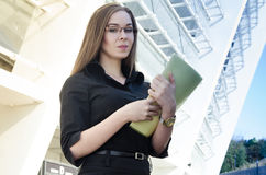 Attractive businesswoman wearing glasses holding a folder Royalty Free Stock Photography