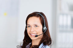 Attractive businesswoman wearing a headset Stock Images
