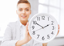 Attractive businesswoman with white clock Stock Photos