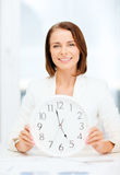 Attractive businesswoman with white clock Royalty Free Stock Photography