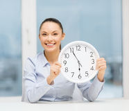 Attractive businesswoman with white clock Royalty Free Stock Photo