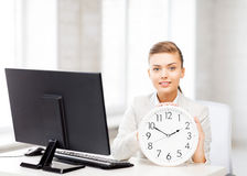 Attractive businesswoman with white clock Royalty Free Stock Image