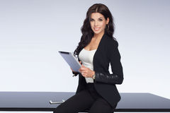 Attractive businesswoman at work. Stock Photo