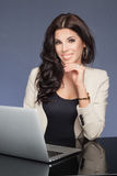 Attractive businesswoman at work. Stock Photos