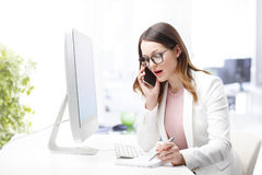 Attractive businesswoman at work Stock Images