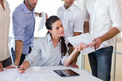 Attractive businesswoman working with businessmen Stock Images