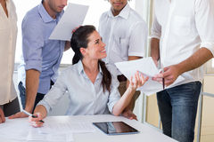 Attractive businesswoman working with businessmen Royalty Free Stock Photo