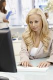 Attractive businesswoman working with computer Royalty Free Stock Images