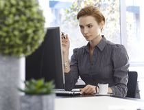 Attractive businesswoman working with computer Stock Image
