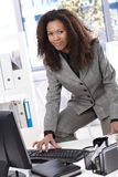 Attractive businesswoman working at desk smiling Royalty Free Stock Photo