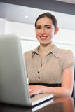 Attractive businesswoman working on her laptop Royalty Free Stock Photography
