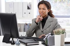 Attractive businesswoman working in office Royalty Free Stock Images