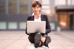 Attractive businesswoman working outdoors Royalty Free Stock Image