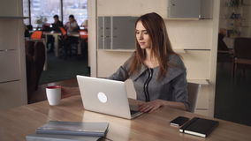 Attractive businesswoman works with computer on the working place in the office. stock video