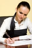 Attractive businesswoman writing Stock Photos