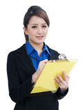 Attractive businesswoman writing on clipboard Stock Photography