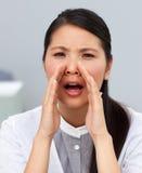 Attractive businesswoman yelling Stock Photo