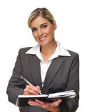 Attractive busineswoman. Young blonde business woman writes in her personal planner Royalty Free Stock Images