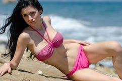 Attractive busty woman in bikini Stock Photography