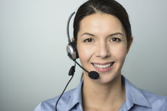 Attractive call center operator wearing a headset Stock Photography