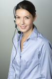 Attractive call center operator wearing a headset Royalty Free Stock Photography