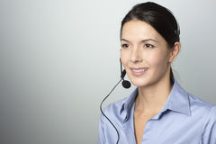 Attractive call center operator wearing a headset Stock Photos