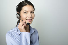 Attractive call center operator wearing a headset Stock Images