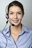 Attractive call center operator wearing a headset Royalty Free Stock Images