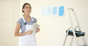 Attractive capable woman redecorating her home Stock Photography