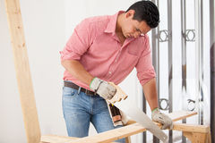 Attractive carpenter at work Royalty Free Stock Photo