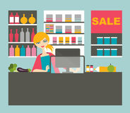 Attractive cashier woman working. Attractive cashier woman working with smile in the supermarket Stock Photography