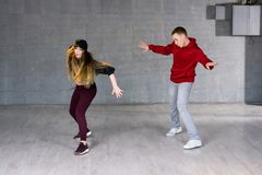Attractive casual couple dancing hip-hop. royalty free stock image