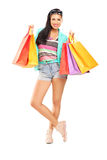 Attractive casual female posing with shopping bags Stock Image