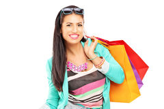 Attractive casual female posing with shopping bags Royalty Free Stock Photography