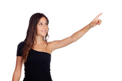 Attractive casual girl in black indicating something Royalty Free Stock Photography