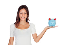 Attractive casual girl with a blue moneybox Stock Photography