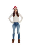 Attractive casual girl with Christmas hat Stock Image