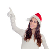Attractive casual girl with Christmas hat pointing something Royalty Free Stock Photography