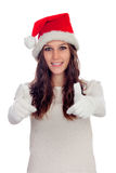 Attractive casual girl with Christmas hat saying Ok Stock Images